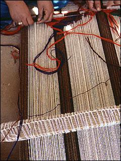 woman making weft twining